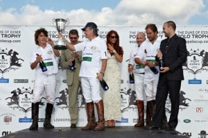 The Only Way is Essex's Amy Childs awards the British team the winner's trophy at the 2011 Duke of Essex Polo match