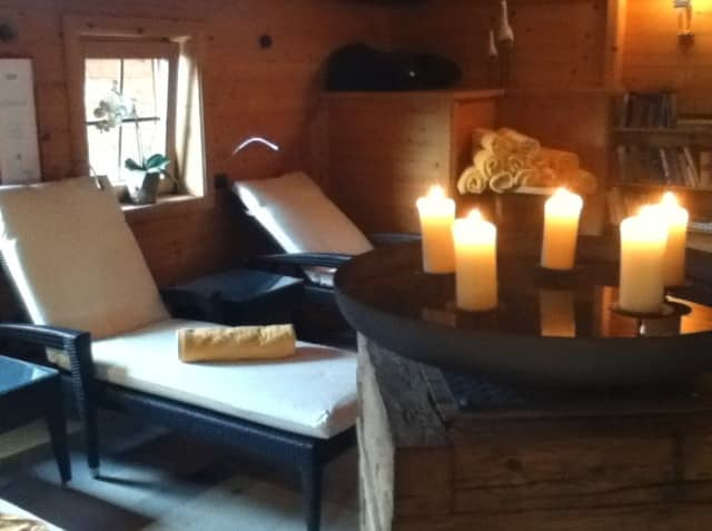 Unwind in the relaxation room at the Romantik Hotel Boeglerhof's mixed nudist spa, Alpbachtal