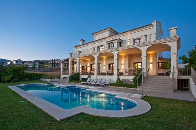 Casa Flamingos house and pool at dusk one of three luxury villas in Marbella offered by DSV