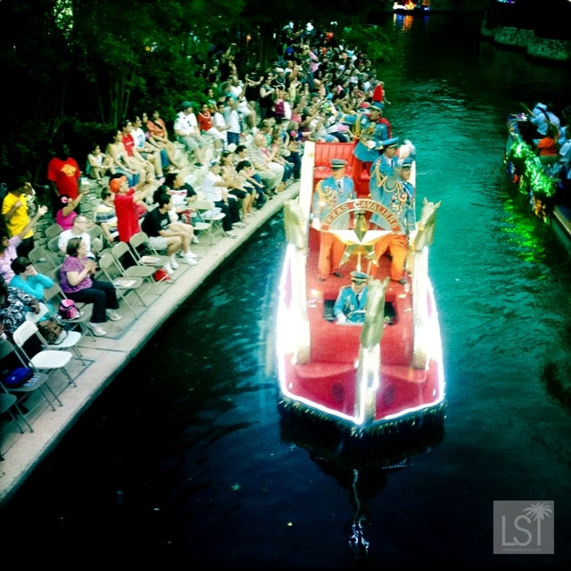 The Texas Cavaliers lead the River Parade during San Antonio Fiesta