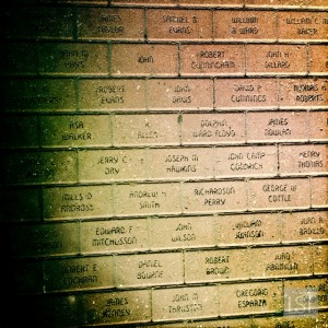 The names of the Alamo defenders in the brickwork of Navarro Street, feet away from the Alamo