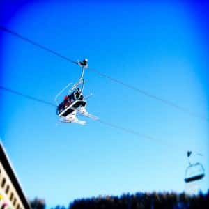 Taking chair lift to my first ski lesson