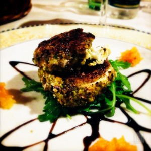 Warm goats cheese with pistachio crust, honey and dried apricot