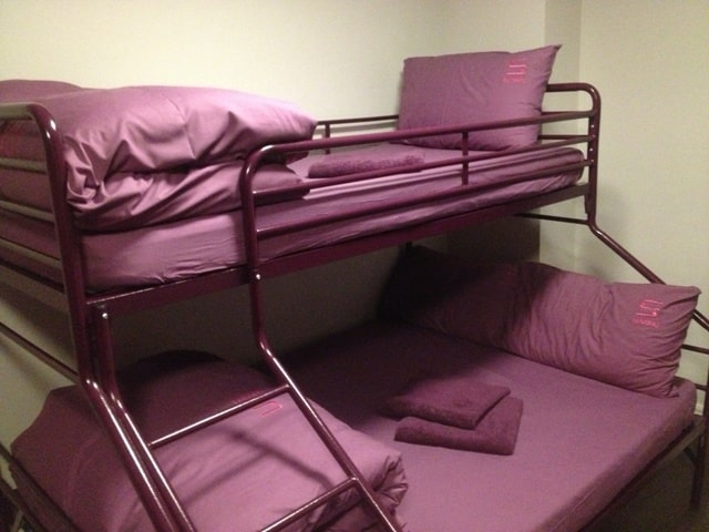 Double bed with single bunk at Safestay London