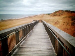Boardwalk and red sand beach in Prince Edward Island, Atlantic Canada
