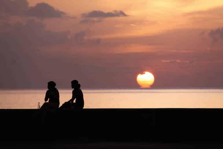 Enjoy sunset over Havana's El Malecon when you travel to Cuba | photo iwanp, Flickr