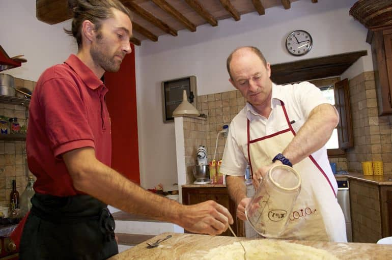 Stefano shows how to make pasta at cooking classes in Italy