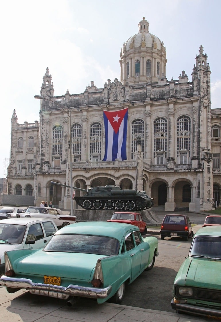 Travel to Cuba to see old fashioned cars outside the Museum of the Revolution | photo: Ahisgett on Flickr