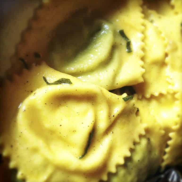 The finished dish - ravioli with pea and nipitella filling