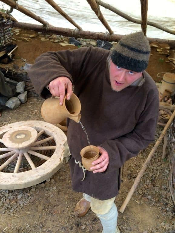 Potter Andy pours us water from his clay pots at the Campus Galli, a project aiming to build a mediaeval monastery using all traditional methods