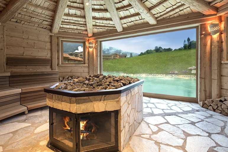 Sauna at Bio-Hotel Stanglwirt with it's natural bathing lake in the background, Tirol Austria