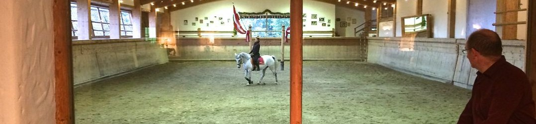 Watching the Lipizzaner horses in training from the lobby of Bio-Hotel Stanglwirt, in Tirol Austria