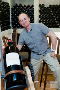 Terry gets to grips with a bottle of wine in the cellars at the Kaiserhof, one of the most luxurious hotels in Austria
