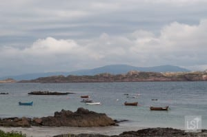 Boats bobbing on the water off Iona, west coast of Scotland