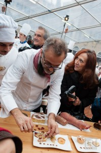 Food in Italy - it's an excited crush as Massimo Bottura assesses the zampone dishes
