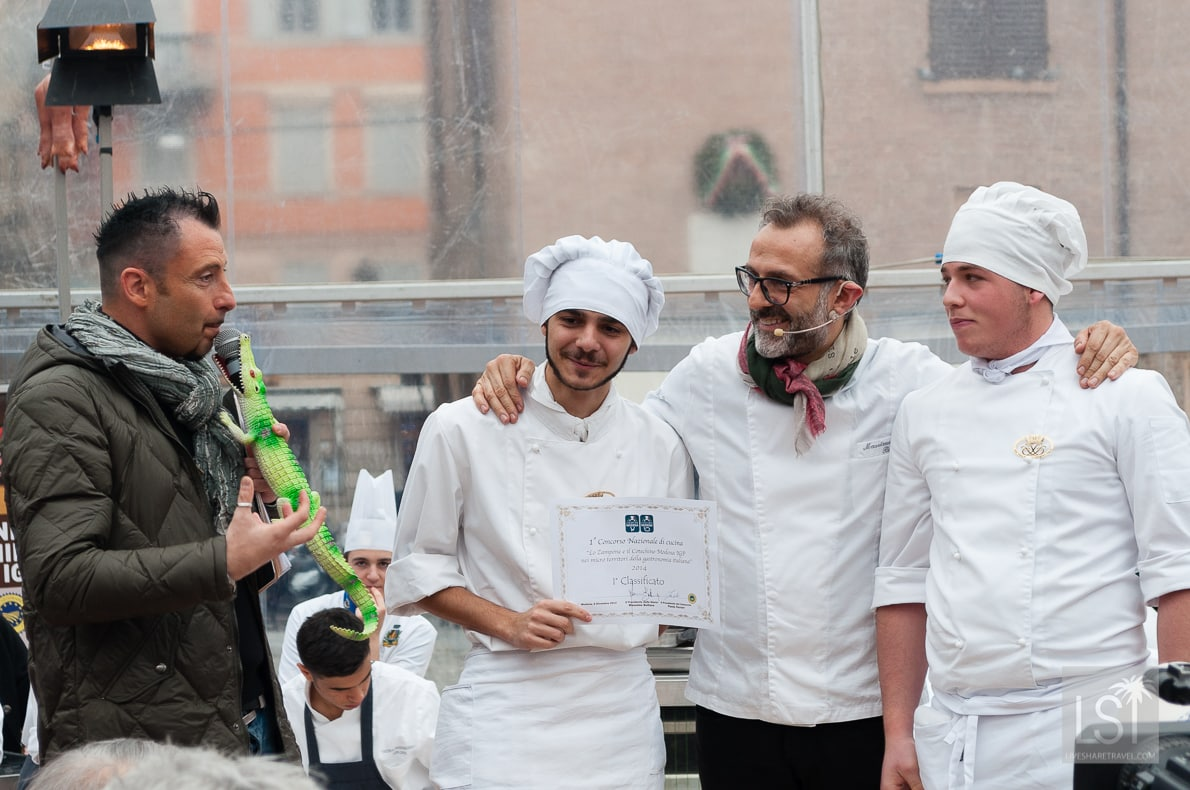 Food in Italy - Massimo Boturra with the zampone competition winners from Naples, being interviewed by a man with a crocodile microphone