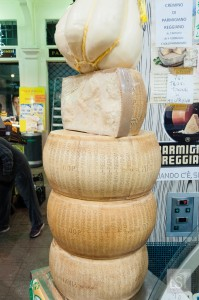 Parmesan stacked up at Cheeses at the Mercato Albinelli, Modena