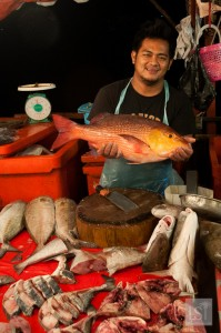 Fish trader at Philippines Market in Kota Kinabalu - one of Sabah's top honeymoon destinations
