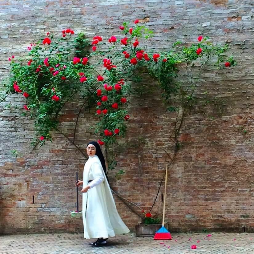 Nun at Santuario di Santa Caterina, in Siena, Tuscany