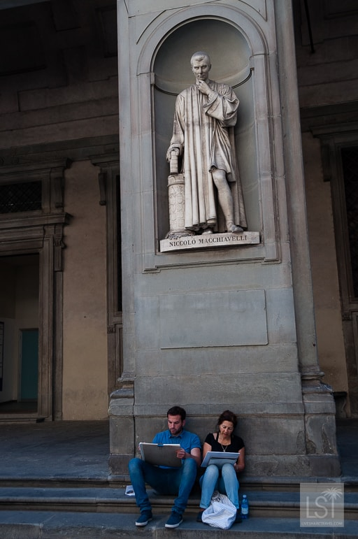 Painting at the feet of Macchiavelli, at the Uffizi in Florence, one of Italy's many great places to go