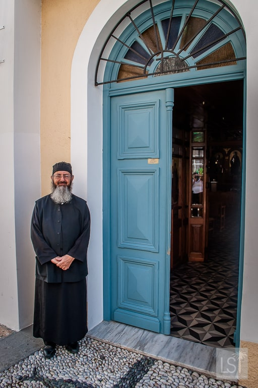 Father outside his church, Spetses Greece