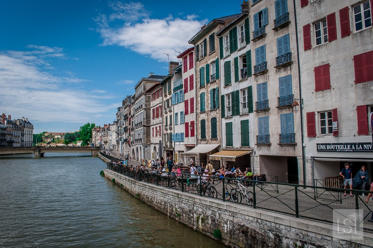 The river Nive in Bayonne, backed by yet more historic buildings