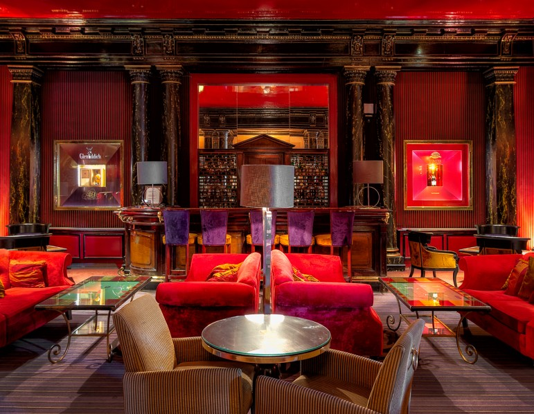 The vibrant bar of the Hotel du Louvre, a luxurious place to stay in Paris