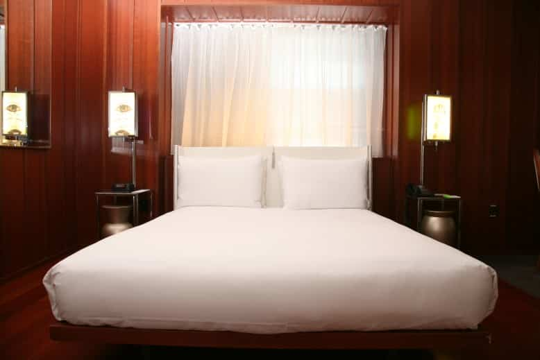Where to stay in New York - luxury wood panelled bedroom at the Hudson Hotel New York I Pic Simon Law
