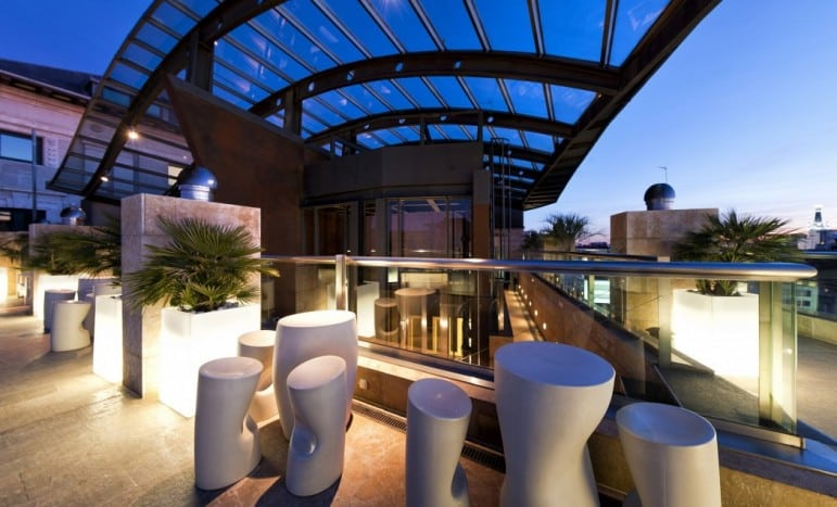Where to stay in Madrid: Outdoor area of Urban Hotel Madrid, featuring one of many art spaces to enjoy the hotel I Pic Derby Hotels
