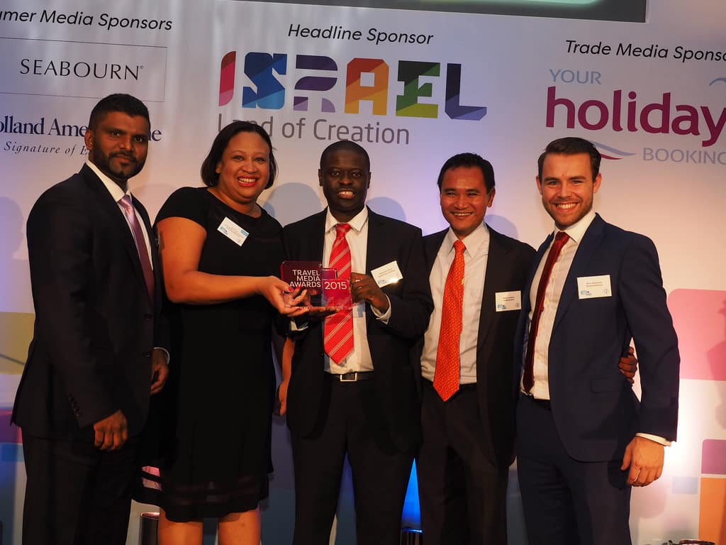 Prasad Rosa, group managing director of LycaFly, presents us with the award for Innovative Campaign & Content of the Year at the Travel Media Awards (l-r) Sarah Lee, Adiel Mambara of Royal Brunei Airlines, Keith Jenkins of iambassador, Matt Robshaw of Good Relations PR
