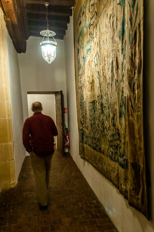 Corridors of Chateau de Bagnols are festooned with tapestries and murals