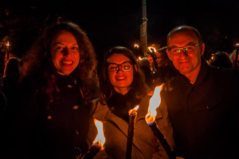 Aurélie, Celia and Terry ready for the Beaujolais Nouveau torchlight procession