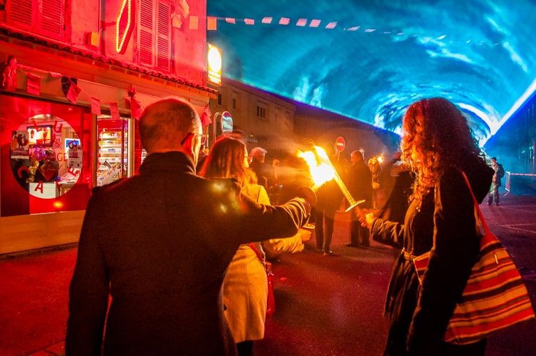 Keeping the torches alight as we march through Beaujeu on Beaujolais Nouveau Day