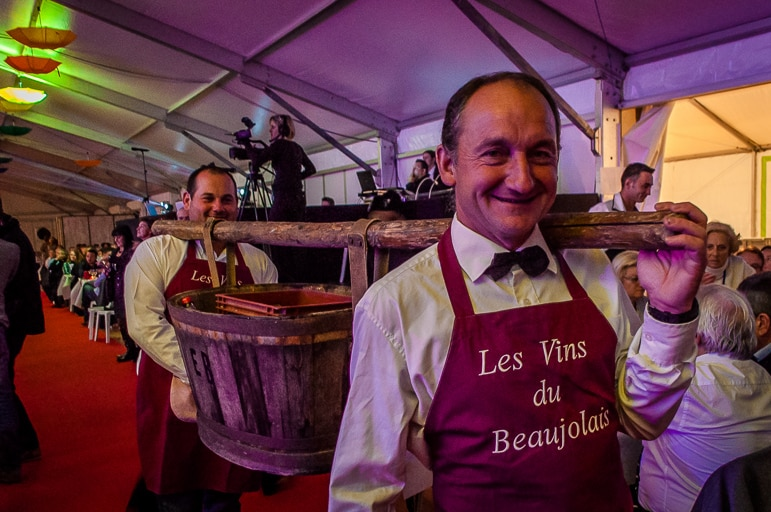 Wine servers at Les Sarmentelles serving the best of wine from the region on Beaujolais Nouveau Day