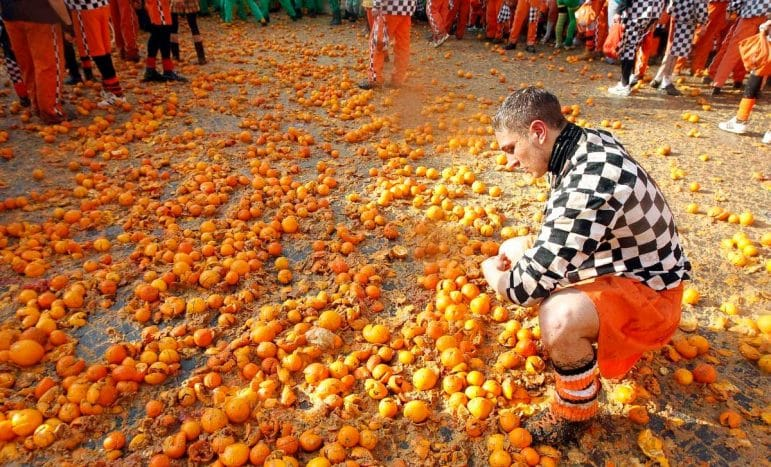 Unusual travel destinations - the Battle of the Oranges in Ivrea, Italy is one of the world's oldest events | Pic: YouTube