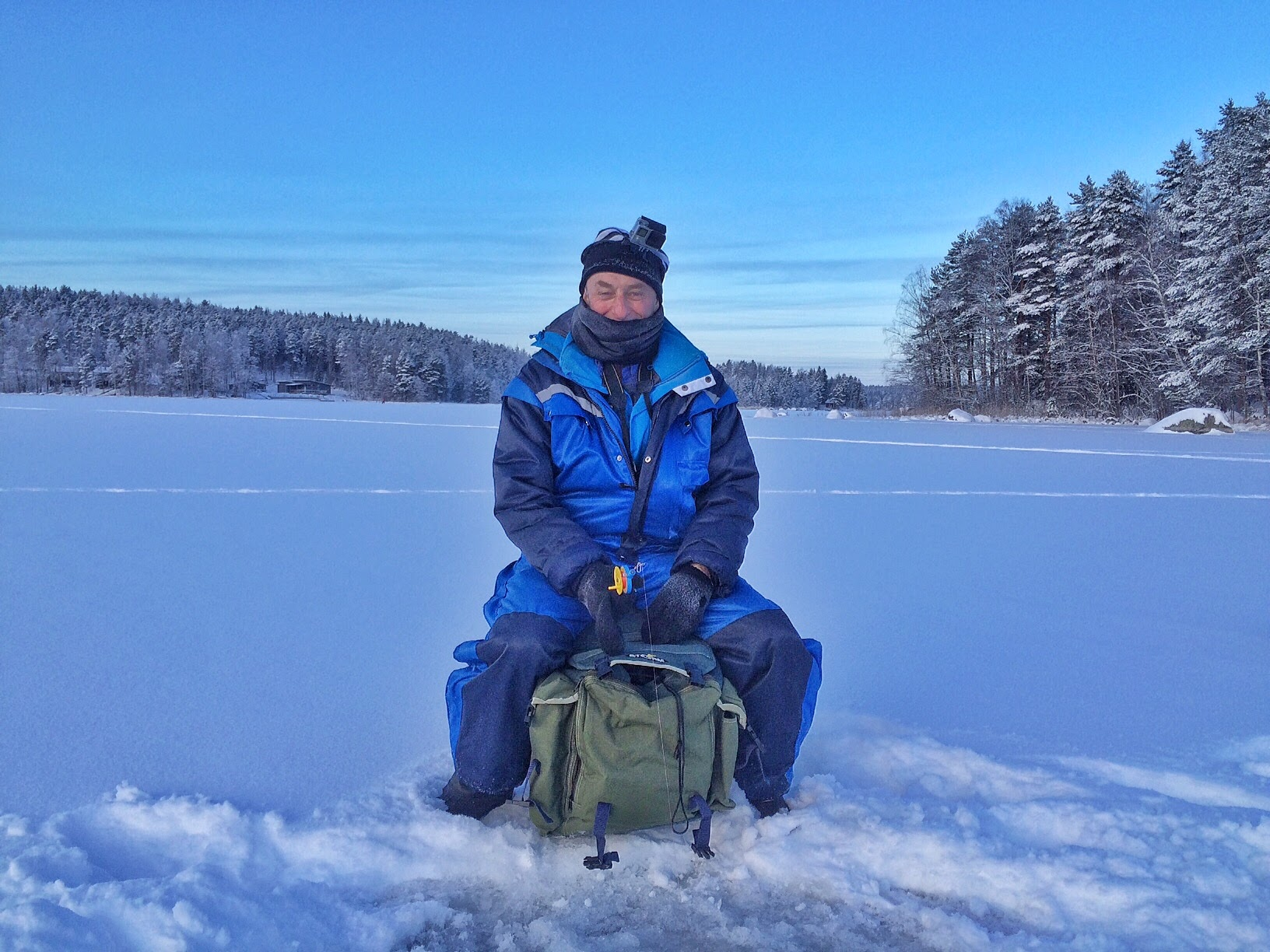 Terry failing to catch anything while Ice fishing on Lake Päijänne, in the land of a thousand lakes