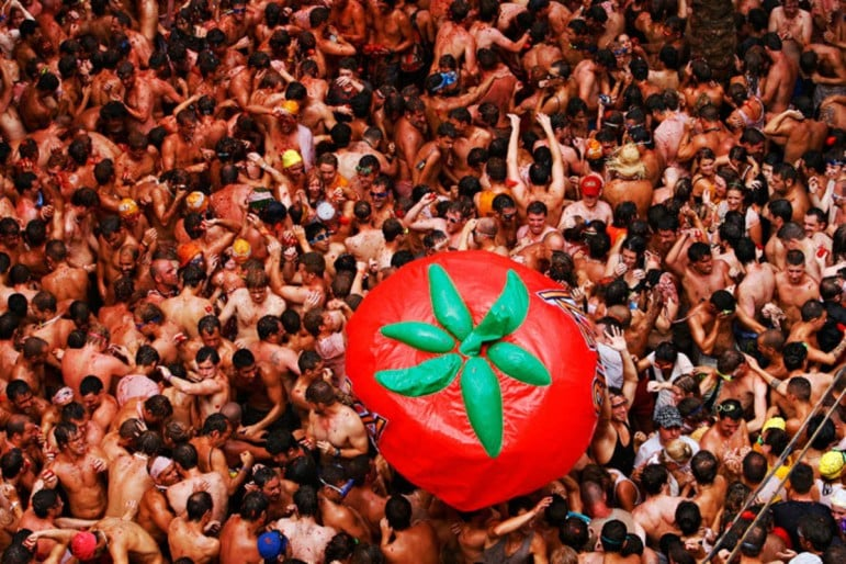 La Tomatina is a world renowned event and one of the most unmissable for fun entertainment | Pic: Travology.in