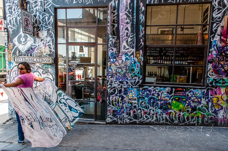 Melbourne to the Great Ocean Road itinerary - my Qantas scarf is part of the art in Hosier Lane