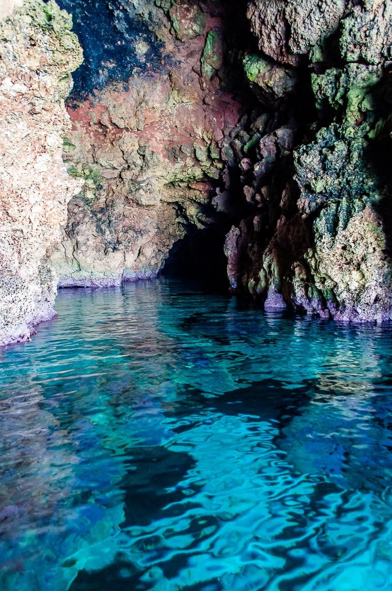 Menorca beaches - a cave secreting away a hidden beach