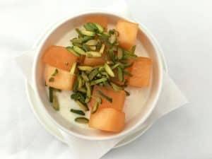 Qantas business class dessert of vanilla and orange blossom cream with melon