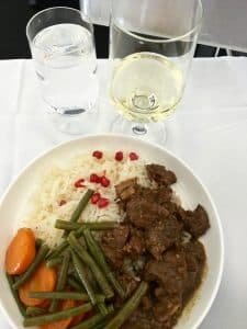 Qantas business class dinner - Persian chicken fesenjan with walnuts, pomegranate, green beans and rice pilaf