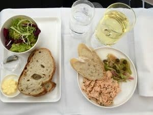 Qantas business class - first course salmon rillettes with sourdough crostini and pickles