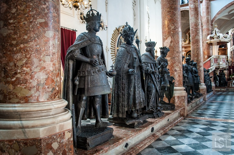 Giant bronze statues stand guard over the empty tomb of Emperor Maximilian I