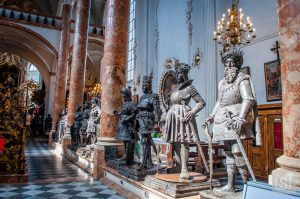 Giant bronze statues stand guard over the tomb of Emperor Maximilian I
