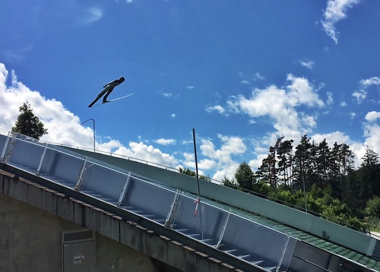 Ski jumper taking flight at Bergisel in Innsbruck, Austria