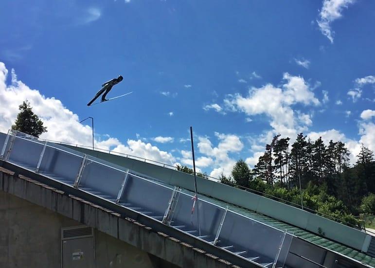 Ski jumper taking flight at Bergisel in Innsbruck, Austria
