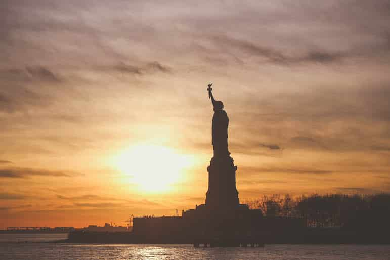 Best fall vacations - sunset over Statue of Liberty New York   pic Lucas Franco