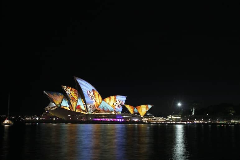 Time your visit to observe the Opera House bathed in beautiful colours
