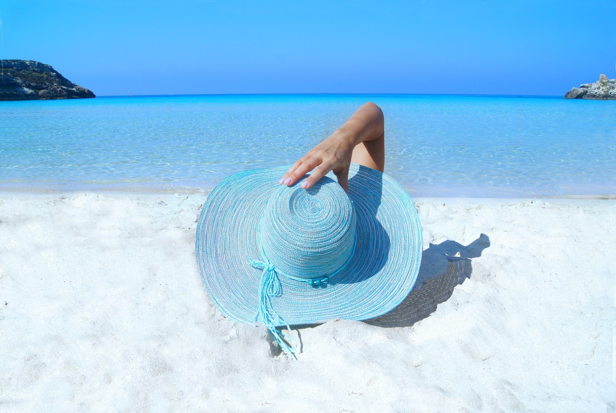 Beach fashion - a blue straw hat shows off beach style