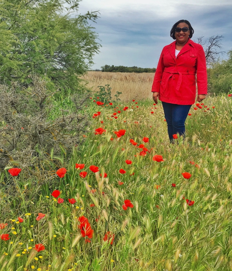 Sarah in among the poppies at Tablas de Daimiel in La Mancha, Spain